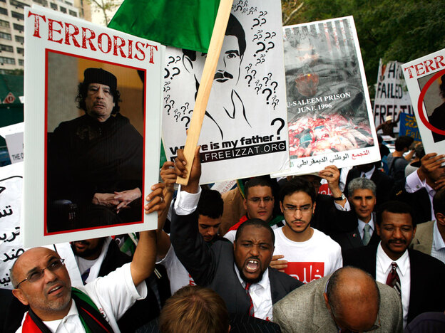 Demonstrators rally against Gadhafi across the street from U.N. headquarters in New York.