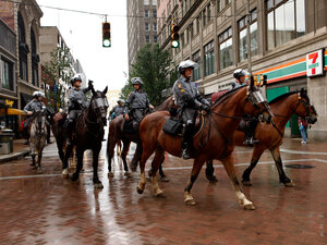 Mounted police patrol the streets of downtown