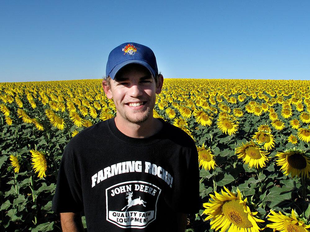 Sunflower grower Grant Allen in a field he planted.