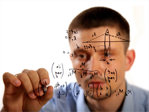 A man writing equations. iStockphoto.com