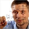 A man writing equations. iStockphoto.com
