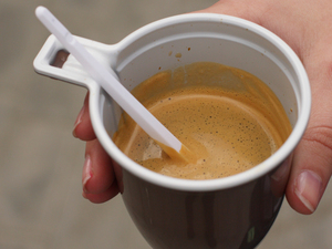 A woman's hand holding a cup of coffee. iStockphoto.com