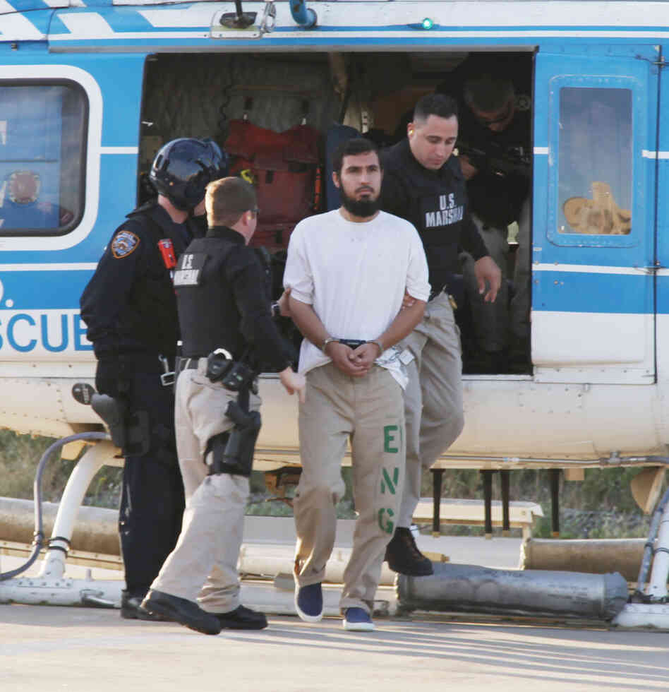 Najibullah Zazi is escorted off a New York Police Department helicopter by U.S. marshals.