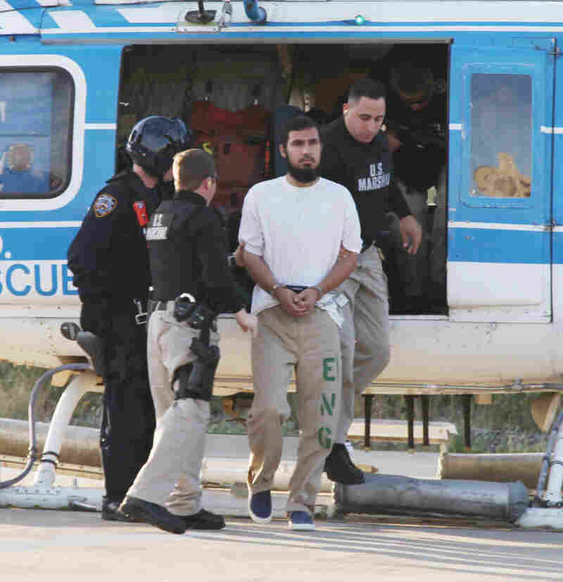 Najibullah Zazi is escorted off a New York Police Department helicopter by U.S marshals