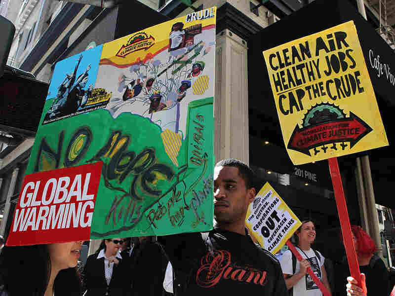 Dozens of demonstrators with the group Mobilization for Climate Justice march