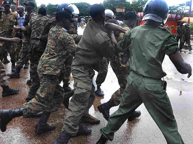 Guinean police arrest a protester