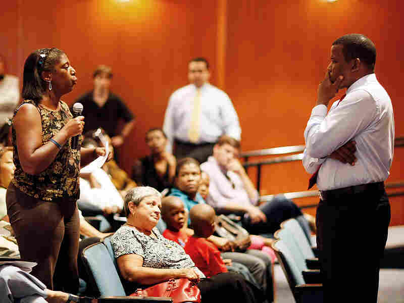 A citizen asks a U.S. Rep. a question at a health care town hall.