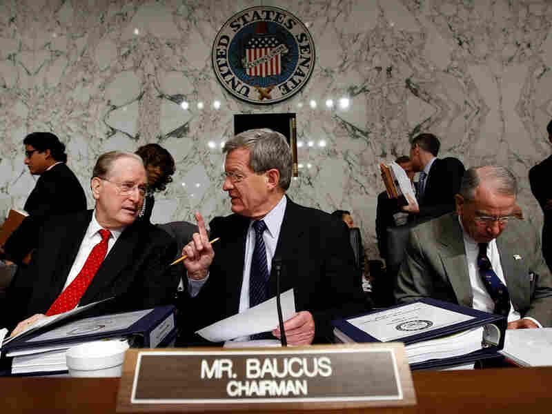 Democratic Sen. John Rockefeller of West Virginia (left) talks with Max Baucus (D-MT).