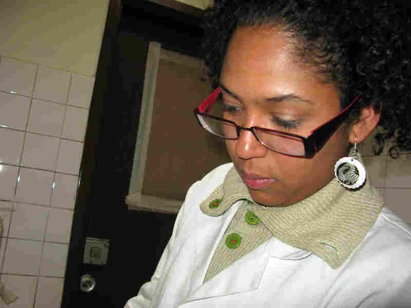 Bela Henriquez works in a government lab.