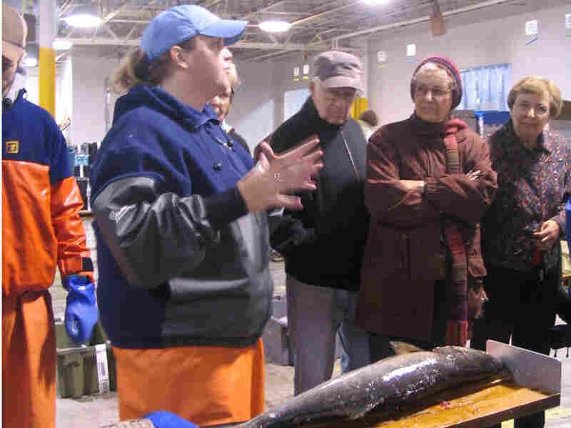 Jodie York, of National Marine Fisheries, speaks to seniors touring the Portland Fish Exchange