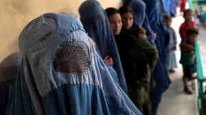 W: Afghan women voting in their country's presidential election in August