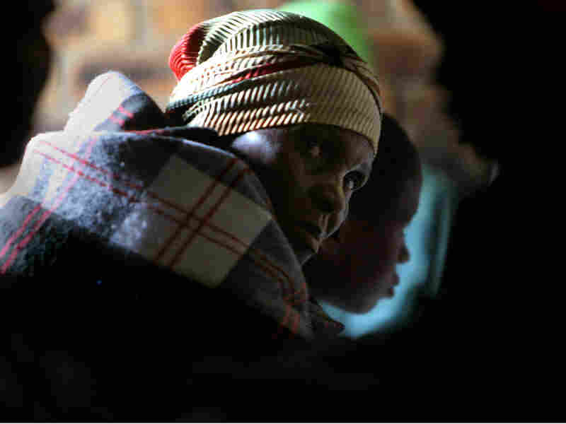 A woman waits in line for treatment at an AIDS clinic in South Africa.