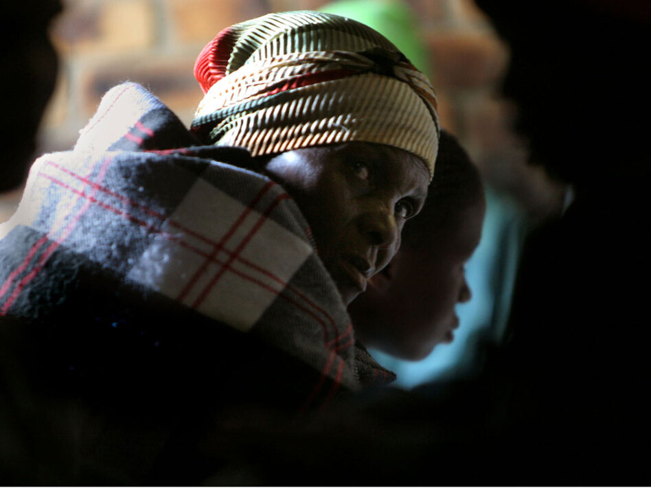 A woman waits in line for treatment at an AIDS clinic in Elandsdoorn, South Africa in 2006. In the last year treatment clinics such as this one have increased antiretroviral treatment greatly.