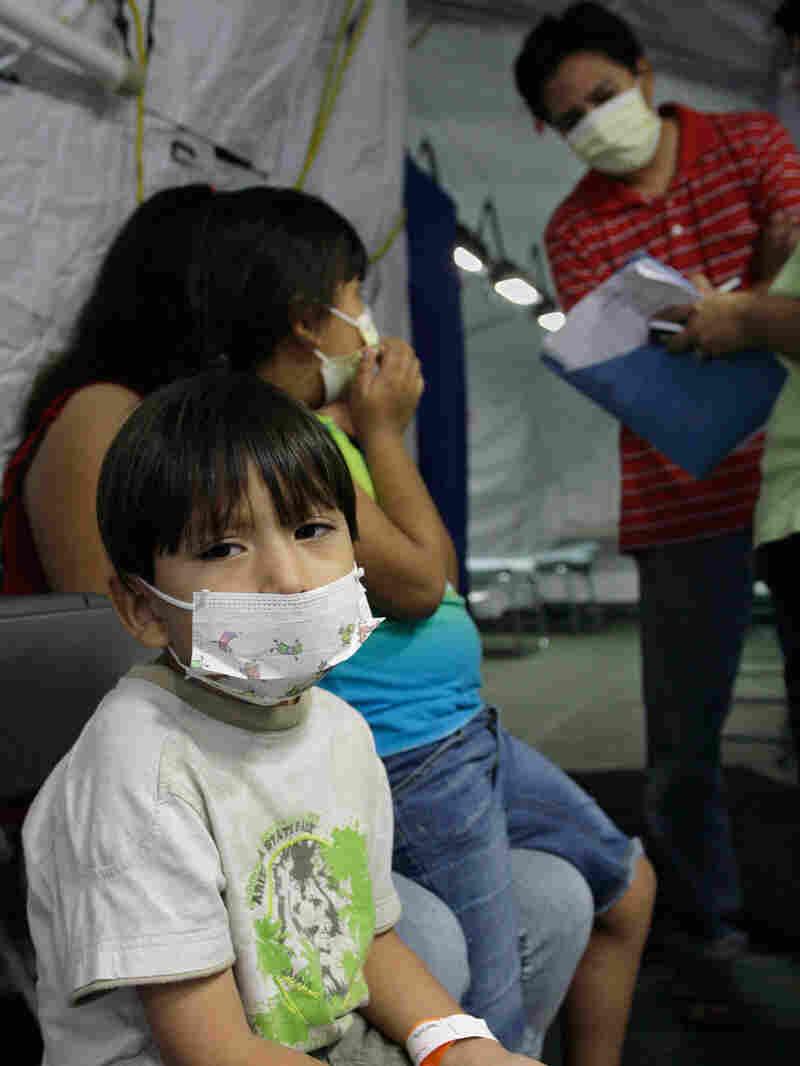 Sammi Jiminez, 4, waits to be examined by a doctor