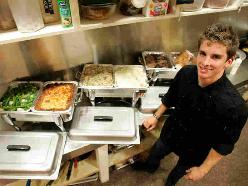 Giants chef Joe Day in the kitchen with some of his dishes.