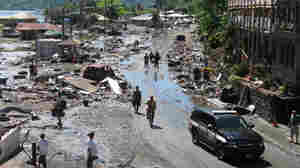 Relief Efforts Under Way In Tsunami-Ravaged Pacific