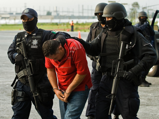 "Miguel Angel Beraza Villa, known as ""The Truck,"" is escorted before the media Aug. 3 in Mexico City. Mexican prosecutors say Beraza moved a half-ton of methamphetamine into the United States each month."
