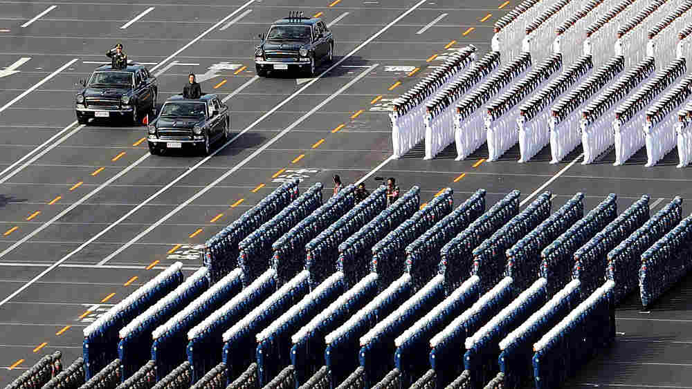 Chinese President Hu Jintao reviews military troops during the 60th-anniversary parade in Beijing.