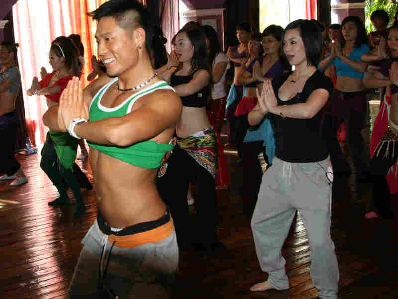 Guo Wei leads a belly dancing class at his studio in Beijing