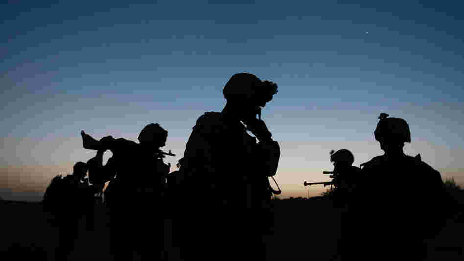 WIDE: U.S. Marines step off in the early morning during an operation in Herati, Afghanistan