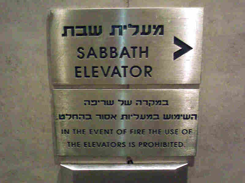 A sign points the way to a Sabbath elevator.