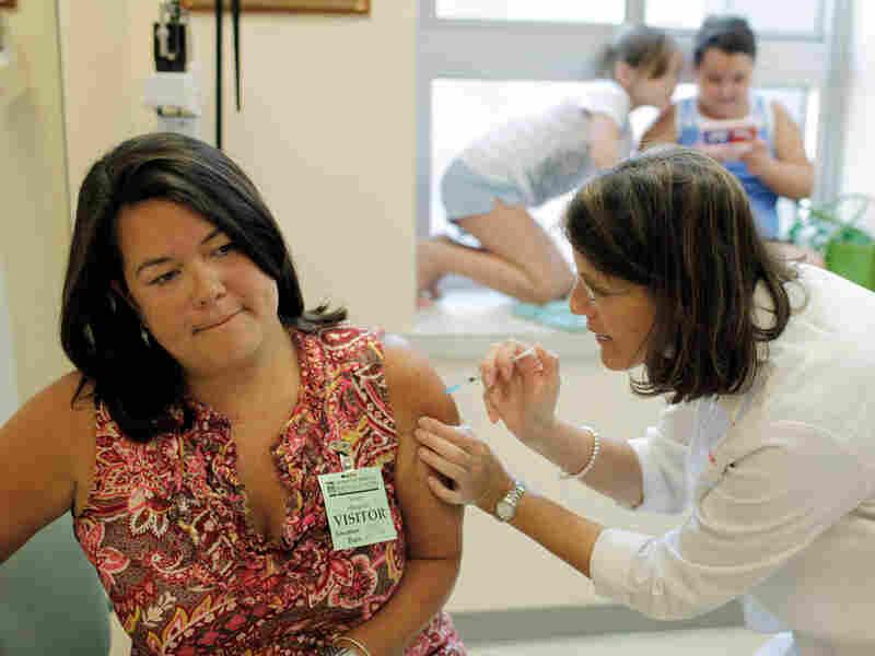 Julie Halverson receives a trial swine flu vaccine.
