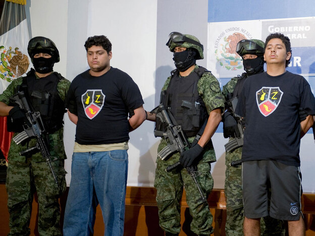 Alleged drug traffickers Christopher Fuentes Letelier (second from left) and Rafael Bautista Delgado (right) are presented to the press in Mexico City on Sept. 9. The two are alleged members of Los Zetas, a notoriously dangerous drug cartel founded by 31 elite Mexican army anti-narcotics commandos.