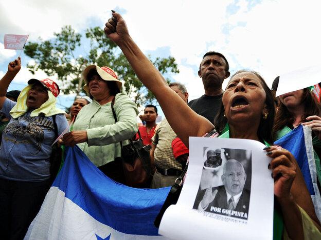 Supporters of deposed Honduran President Manuel Zelaya protest Saturday in the El Pedregal neighborhood of Tegucigalpa, the Honduran capital. (AFP/Getty Images)