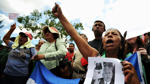 Supporters of deposed Honduran President Manuel Zelaya protest Saturday in the El Pedregal neighborhood of Tegucigalpa, the Honduran capital.
