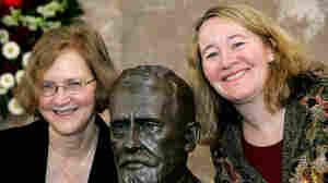 Biologists Elizabeth H. Blackburn and Carol Greider pose next to a bust of Paul Ehrlich.