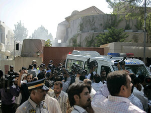 A crowd massed outside the World Food Program in Islamabad, Pakistan, after a suicide blast.
