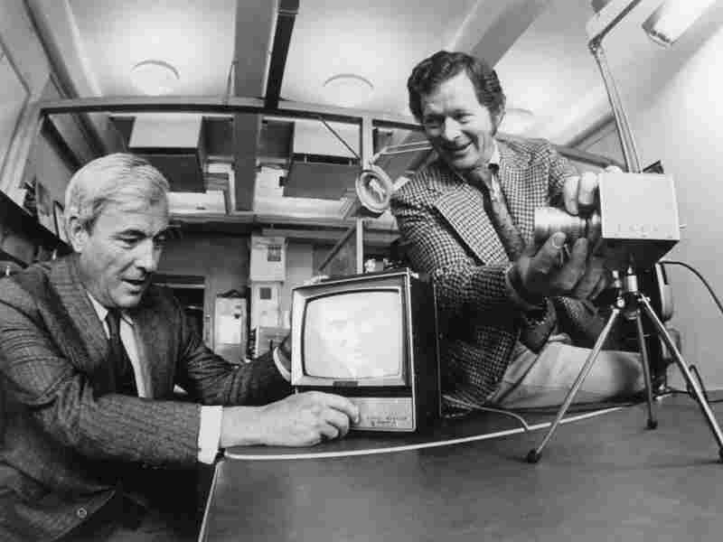 Willard Boyle and George Smith demonstrating a video camera that uses a CCD sensor.