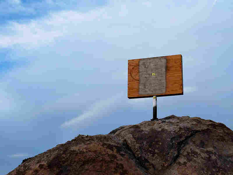 Pending legal review, the cross at the Mojave National Preserve is now hidden within a plywood box.