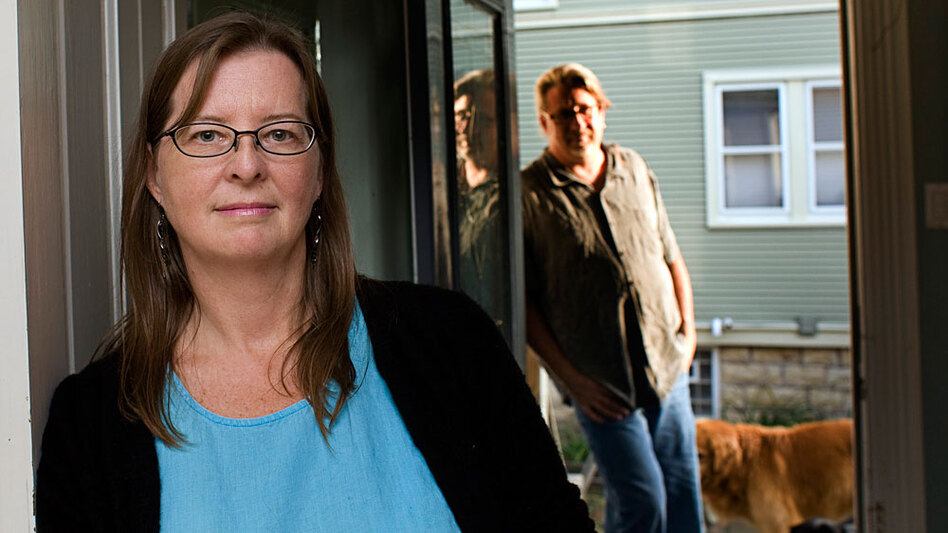 Cindy Richards and her husband Scott Fisher at their home  in Oak Park, Illinois on Wednesday, September 23, 2009. Richards is a freelance writer/editor and part time journalism instructor who buys her own health insurance to cover herself and her family.