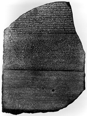 The Rosetta Stone shows identical text in three languages: hieroglyphs, Egyptian and ancient Greek.