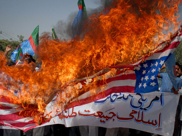 Protesters rally against the U.S. in Multan, Pakistan, on Wednesday. The country's leaders are jousting over a multibillion-dollar U.S. humanitarian aid bill, which critics say will lead to greater American interference in Pakistani affairs.