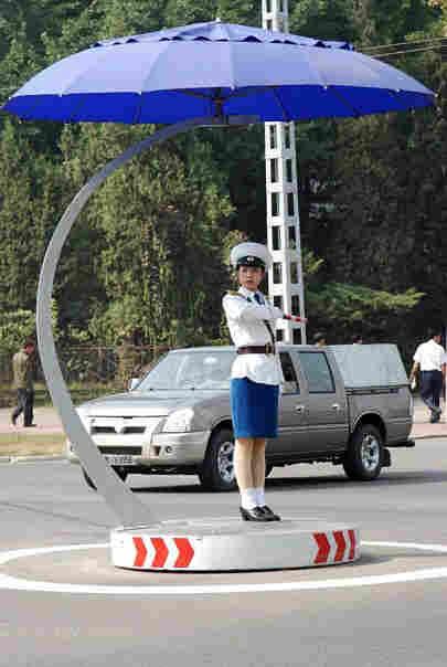 Women, not lights, control traffic in Pyongyang