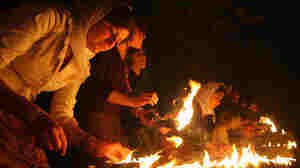WIDE: Iraqi Yazidis light candles outside Lalish temple in 2007.