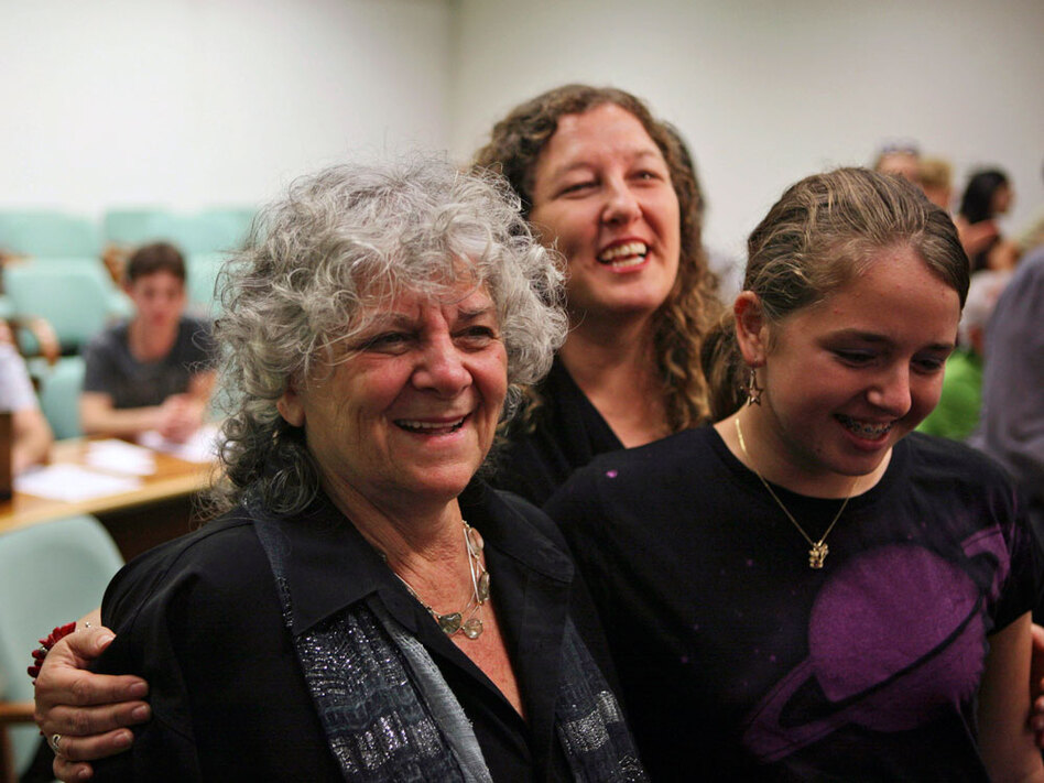 Ada Yonath poses with her daughter, Hagit, and granddaughter, Noa, during a  press conference celebrating her win of the 2009 Nobel Prize in Chemistry at the Weizmann Institute of Science in Rechovot, Israel.