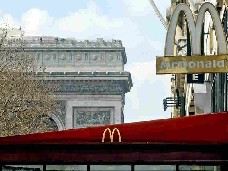 A McDonald's fast food restaurant on the Champs-Elysees in Paris overlooks the Arc de Triomphe.