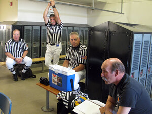 Officials working the game pitting Battleground High School against Heritage High School