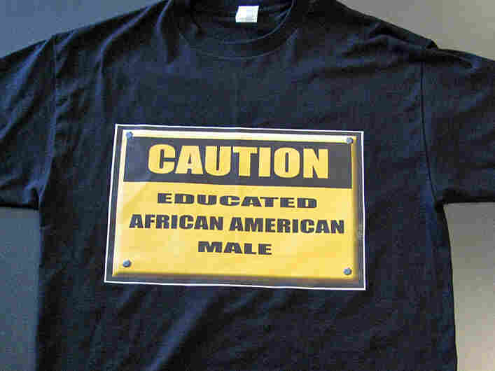 "A T-shirt that reads ""Caution: Educated African-American Male."""