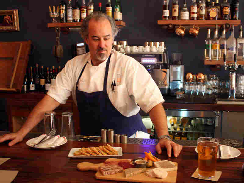 Chef Michael Dotson, shown behind the bar at British gastro pub Martins West.