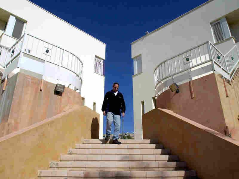 Bryan Meadan walks down the stairs of the urban Kibbutz Tamuz.