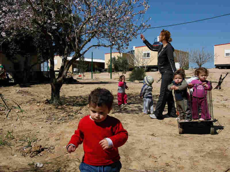 Israeli children walk through Kibbutz Kramim.