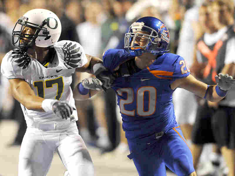 Willie Glasper of the Oregon Ducks battles for position with Mitch Burroughs of Boise State.