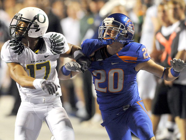 <strong>Held Back?</strong> Even though Mitch Burroughs (right) and the Boise State Broncos beat Oregon in September, Oregon could have a better chance of reaching a BCS game in January.