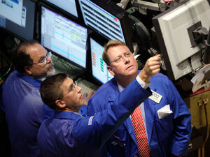 Traders work on the floor of the New York Stock Exchange on July 23.