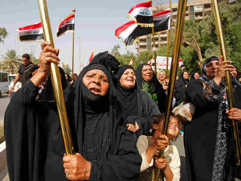 Iraqis chant slogans during a demonstration calling for an open list in the next election.
