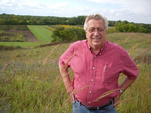 Wes Jackson, founder of the Land Institute, standing in front of prairie in Salina, Kansas